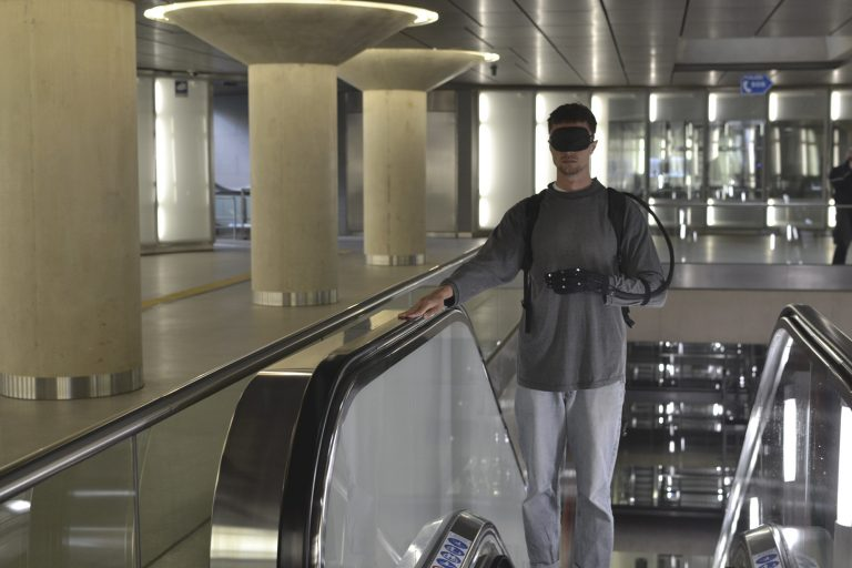 A person using the prototype to navigate through an underground train station
